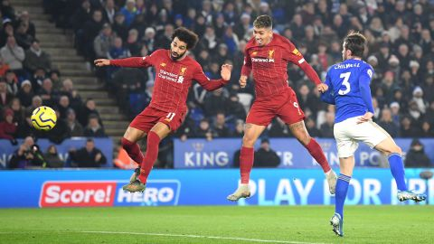 Roberto Firmino heads Liverpool in front in close company with fellow striker Mo Salah in the top of the table clash with Leiceser City at the the King Power Stadium.