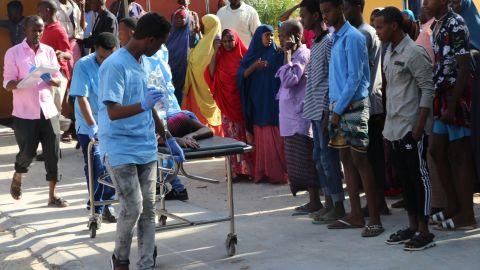 Nurses from Mogadishu's Madina Hospital push a wounded person on a stretcher.