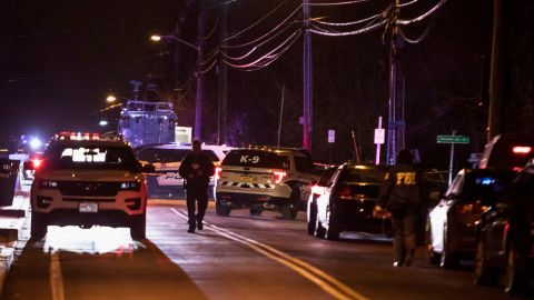 Authorities gather on a street in Monsey, N.Y., Sunday, Dec. 29, 2019, following a stabbing late Saturday during a Hanukkah celebration. A man attacked the celebration at a rabbi's home north of New York City late Saturday, stabbing and wounding several people before fleeing in a vehicle, police said. (AP Photo/Allyse Pulliam)