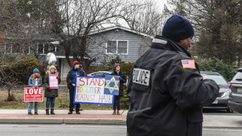 MONSEY, NY - DECEMBER 29: People hold signs of support near the house of Rabbi Chaim Rottenberg on December 29, 2019 in Monsey, New York. Five people were injured in a knife attack during a Hanukkah party and a suspect, identified as Grafton E. Thomas, was later arrested in Harlem. (Photo by Stephanie Keith/Getty Images)