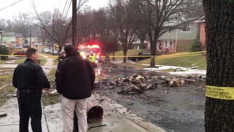 Debris littered the residential street after the plane crash in Lanham, Maryland.