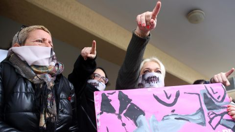"""Protesters stage a demonstration outside a court house in Paralimni, Cyprus on Monday, December 30, 2019, in support of a 19 year-old British woman who was found guilty of fabricating claims that she was gang raped by 12 Israelis. Announcing his verdict, Judge Michalis Papathanasiou said the defendant didn't tell the truth and tried to deceive the court with """"convenient""""and """"evasive"""" statements in court. She is due to be sentenced on Jan. 7.(AP Photo/Philippos Christou)"""