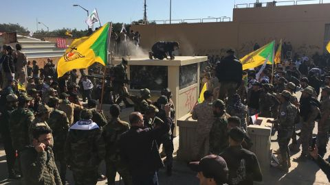 Iraqi protesters try to storm the US Embassy in Baghdad on Tuesday.