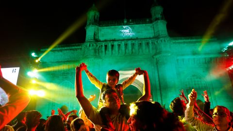 People celebrate New Year's Eve in front of the Gateway of India in Mumbai.