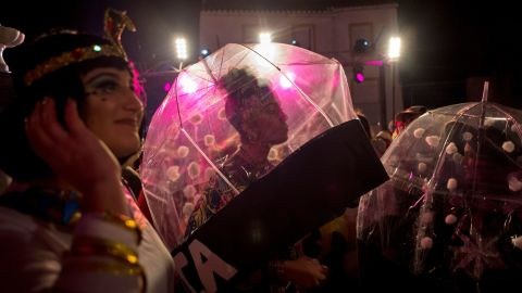 People in costumes gather to welcome the new year in Coin, Spain.