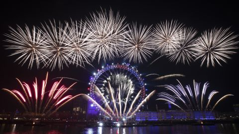 Fireworks explode over the London Eye by the River Thames in London.