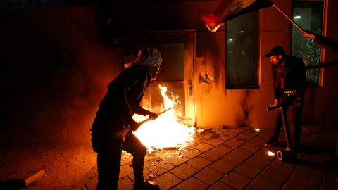 Protesters set fire to a reception room of the US Embassy in Baghdad, Iraq, on Tuesday, December 31. The embassy was attacked during demonstrations in response to recent airstrikes in Iraq and Syria conducted by US forces.