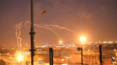 A US Army Apache helicopter drops flares over Baghdad in a show of force.