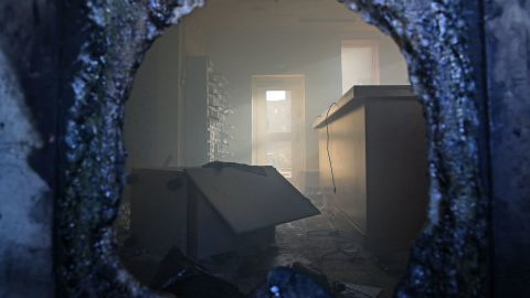 A picture taken through a broken window shows a vandalized room in the embassy.