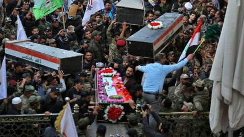 Mourners carry the coffins of Iranian-backed paramilitary fighters in Najaf, Iraq, on December 31. The fighters were killed in US airstrikes on Sunday that sparked Tuesday's attacks on the US Embassy in Baghdad.