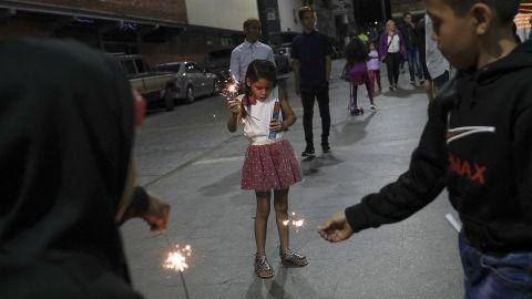 Children play with sparklers in Caracas, Venezuela.