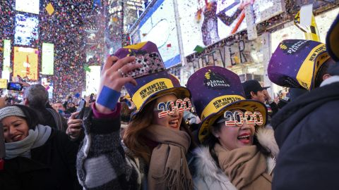 People celebrate as confetti falls in New York's Times Square.