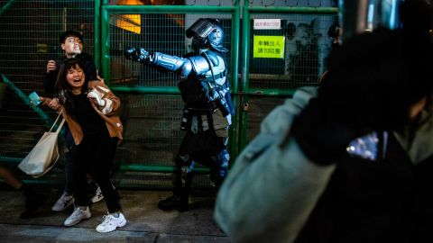 Police arrive to conduct a clearance operation in the Kowloon district of Hong Kong on December 31.