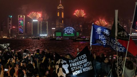 Pro-democracy supporters wave flags during a countdown party in Tsim Sha Tsui district on New Year's Eve.