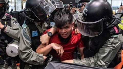 A man is detained by riot police during a demonstration in a shopping mall at Sheung Shui district on December 28.