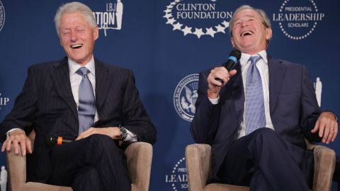 Clinton and former President George W. Bush share a laugh during a September 2014 event launching the Presidential Leadership Scholars program at the Newseum in Washington, DC.
