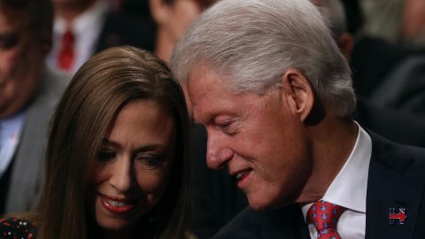Clinton talks to his daughter, Chelsea, before the start of one of Hillary's presidential debates in October 2016.