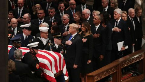President Donald Trump and first lady Melania Trump join the Clintons and other former Presidents and first ladies at the state funeral for George H.W. Bush in December 2018.