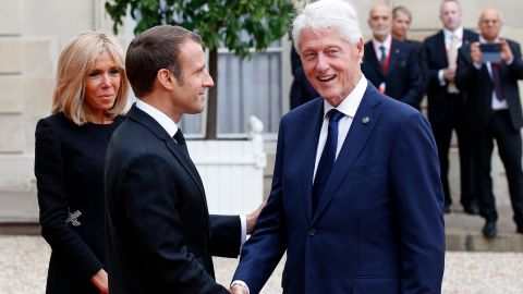 French President Emmanuel Macron and his wife, Brigitte, welcome Clinton for a lunch in Paris in September 2019. Clinton was in France to pay tribute to the late French President Jacques Chirac.