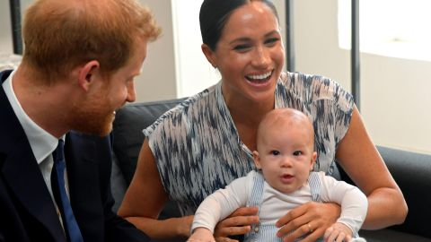 Meghan holds Archie during the South African tour.