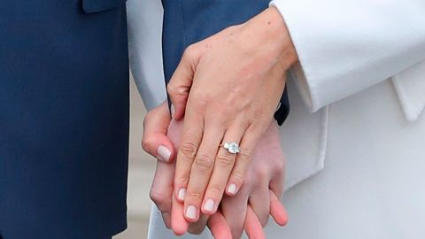 Meghan flashed her engagement ring to reporters during a November 2017 photo call. The ring, designed by Harry, featured a large diamond from Botswana and two smaller outer diamonds from the personal collection of Harry's late mother.