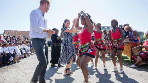 Harry and Meghan dance during their royal tour of South Africa in September 2019.