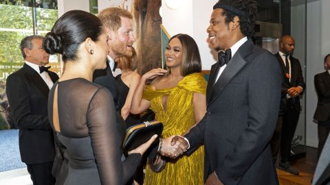 """Harry and Meghan greet singer Beyoncé and her husband, rapper Jay-Z, as they attend the European premiere of the film """"The Lion King"""" in July 2019."""