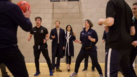 The couple watches Coach Core apprentices take part in a training exercise in Birmingham, England, in March 2018. The Coach Core apprenticeship scheme was designed by the Royal Foundation to train young people to become sports coaches and mentors within their communities.