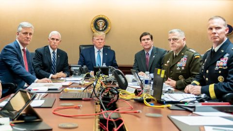 In this photo released by the White House, President Trump sits in the White House Situation Room, monitoring developments in the October 2019 military raid that killed ISIS leader Abu Bakr al-Baghdadi in northwest Syria. From left are national security adviser Robert O'Brien; Pence; Trump; Defense Secretary Mark Esper; Gen. Mark Milley, the chairman of the Joint Chiefs of Staff; and Brig. Gen. Marcus Evans, the deputy director for special operations on the Joint Staff.
