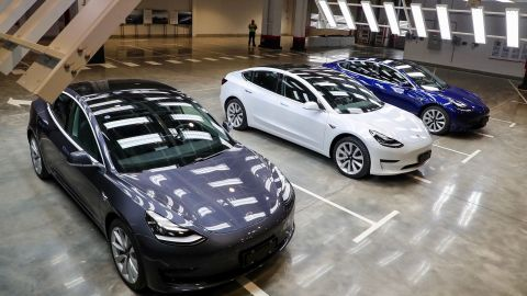 """Tesla Model 3 cars are displayed during the Tesla China-made Model 3 Delivery Ceremony in Shanghai. - Tesla CEO Elon Musk presented the first batch of made-in-China cars to ordinary buyers on January 7, 2020 in a milestone for the company's new Shanghai """"giga-factory"""", but which comes as sales decelerate in the world's largest electric-vehicle market. (Photo by STR / AFP) / China OUT (Photo by STR/AFP via Getty Images)"""