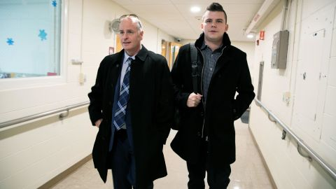 Jim Morgan, chairman of the New Hampshire Log Cabin Republicans (left), and his husband, Paul Michael Freitas, leave an event hosted by the Rockingham County Young Republicans, on January 18, 2020, in Brentwood, New Hampshire.