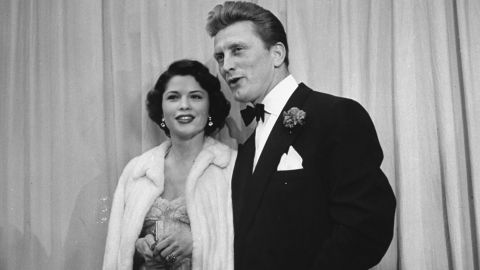 """Douglas escorts Irene Wrightsman McEvoy to the Academy Awards in March 1950. He was nominated that year for best actor for his breakout role in """"Champion."""" He would also be nominated for """"The Bad and the Beautiful"""" and """"Lust for Life."""" He received an honorary Academy Award in 1996."""