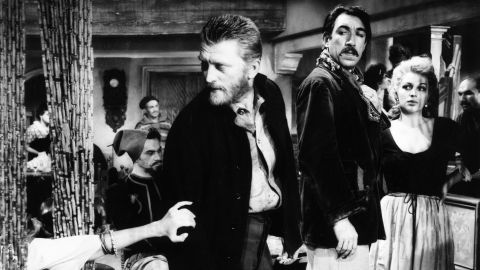 """Douglas stars as Vincent van Gogh in director Vincente Minnelli's film about the Dutch painter, """"Lust for Life"""" (1956). Co-star Anthony Quinn, right, won the best supporting actor Oscar for his role as rival Paul Gauguin."""