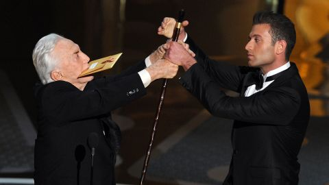 Douglas helps present an Academy Award in 2011.