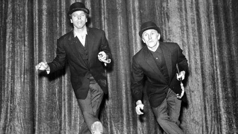 """Douglas, right, rehearses with Burt Lancaster in preparation for the """"Night of 100 Stars"""" event in London in 1958. The two stars appeared in five films together, from """"Gunfight at the O.K. Corral"""" (1957) to """"Tough Guys"""" (1986)."""