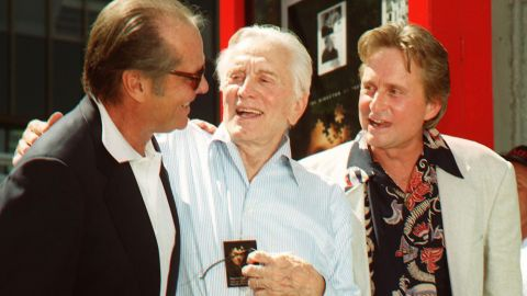 Actor Jack Nicholson greets Douglas after a ceremony honoring Michael Douglas in 1997. Michael placed his hands and footprints in cement at Grauman's Chinese Theatre, a Hollywood landmark.