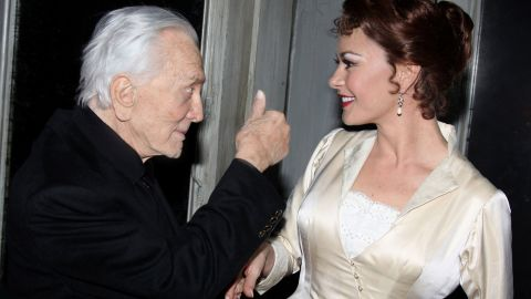 """Douglas greets his daughter-in-law Catherine Zeta-Jones backstage at Broadway's """"A Little Night Music"""" in 2009. She was starring in a revival of the Stephen Sondheim-Hugh Wheeler musical."""