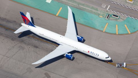Businesses can earn up to a $100 Delta flight credit after spending $10,000 in a year on the Delta Gold Business Amex credit card.