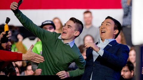 """Yang takes a photo with an audience member as he arrives at an """"Our Rights, Our Courts"""" forum in Concord, New Hampshire, in February 2020."""