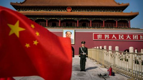 BEIJING, CHINA - OCTOBER 27: A Chinese soldier stands guard in front of Tiananmen Gate outside the Forbidden City on October 27, 2014 in Beijing, China.  (Photo by Kevin Frayer/Getty Images)