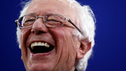 """Sanders laughs during a primary-night rally in Manchester, New Hampshire, in February 2020. Sanders won <a href=""""https://www.cnn.com/2020/02/09/politics/gallery/new-hampshire-primary-2020/index.html"""" target=""""_blank"""">the primary,</a> just as he did in 2016."""