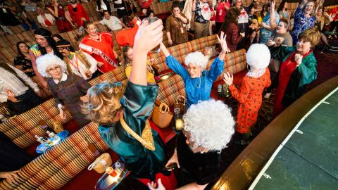 """Fans of """"The Golden Girls"""" live it up during the Golden Fans at Sea costume contest."""