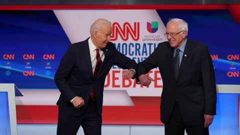 Biden greets Sanders with an elbow bump before the start of a debate in Washington in March 2020. They went with an elbow bump instead of a handshake because of the coronavirus pandemic.