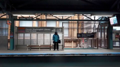"""CHICAGO, ILLINOIS  - MARCH 20: A commuter waits for an """"L"""" train during rush hour in the Loop on March 20, 2020 in Chicago, Illinois. The train platform would normally be full of commuters at this hour but most companies have elected to have their employees telecommute to help curtail the spread of Covid-19. (Photo by Scott Olson/Getty Images)"""
