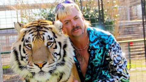 "Joseph Maldonado-Passage aka Joe Exotic and one of his cats in the Netflix docuseries ""Tiger King: Murder, Mayhem and Madness."""