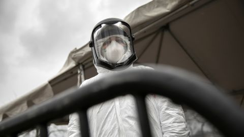 Nurse Hannah Sutherland, dressed in personal protective equipment (PPE) awaits new patients at a drive-thru coronavirus testing station at Cummings Park on March 23, 2020 in Stamford, Connecticut.
