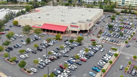 You'll need to trek to a physical Costco store to exchange your rewards certificate for cash.