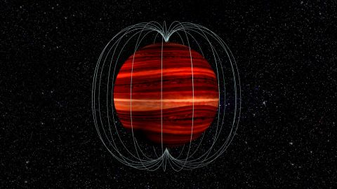 """This is an artist's illustration of a brown dwarf, or a """"failed star"""" object, and its magnetic field. The brown dwarf's atmosphere and magnetic field rotate at different speeds, which allowed astronomers to determine wind speed on the object."""