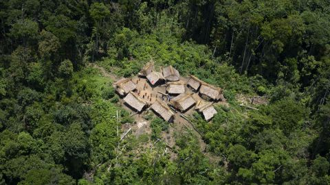 Aerial view of Irotatheri community, in Amazonas state, southern Venezuela, 19 km away from the border with Brazil, on September 7, 2012. The Venezuelan government on Friday agreed to lead a delegation of national and international media to Irotatheri after a slaughter of 80 Yanomami natives was reported. Venezuelan militarymen detected evidence of illegal mining in the south of the country, where Yanomami natives would have presumably been massacred by Brazilian illegal gold prospectors.  AFP PHOTO/Leo RAMIREZ        (Photo credit should read LEO RAMIREZ/AFP/GettyImages)