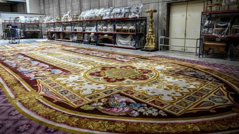 A carpet from Notre Dame cathedral undergoes restoration at 'the Mobilier National' headquarters in Paris on September 12, 2019.